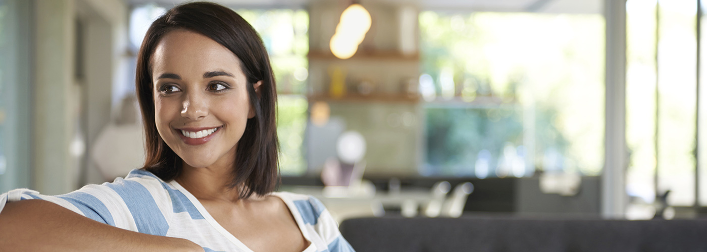 Woman smiling and looking back on couch