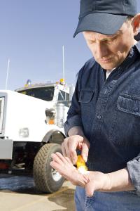 Truck driver dispensing medicine