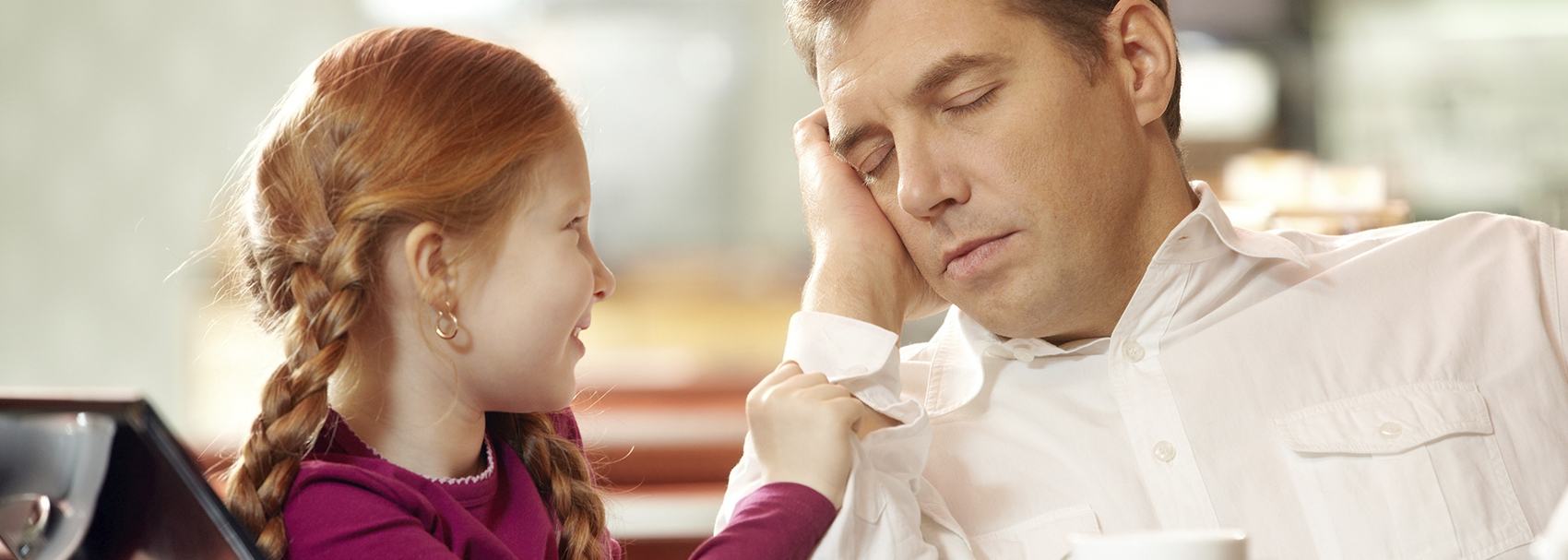 Daughter watches father sleep