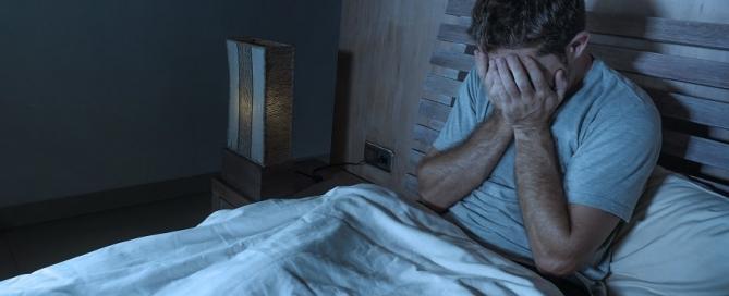 Man experiencing depression due to sleep apnea.