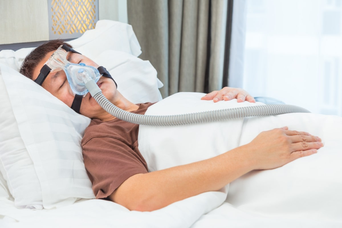 Man wearing a CPAP mask for sleep apnea.