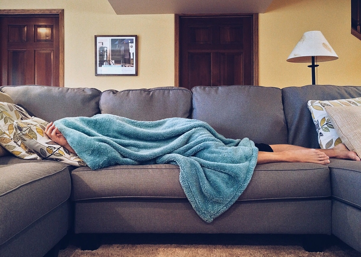 Man who has fallen asleep on the couch after eating.